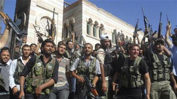 گروهی از انقلابیون  ارتش آزاد سوریه در روز پنجشنبه گذشته -عکس از رویترز